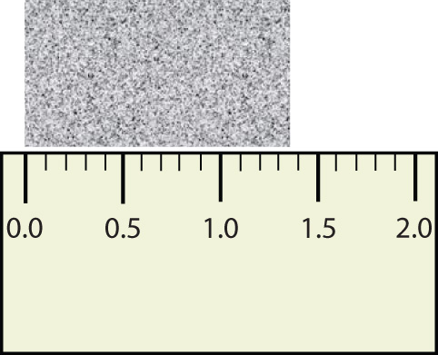 Part of a ruler measuring an object that is over 1 centimeter long.