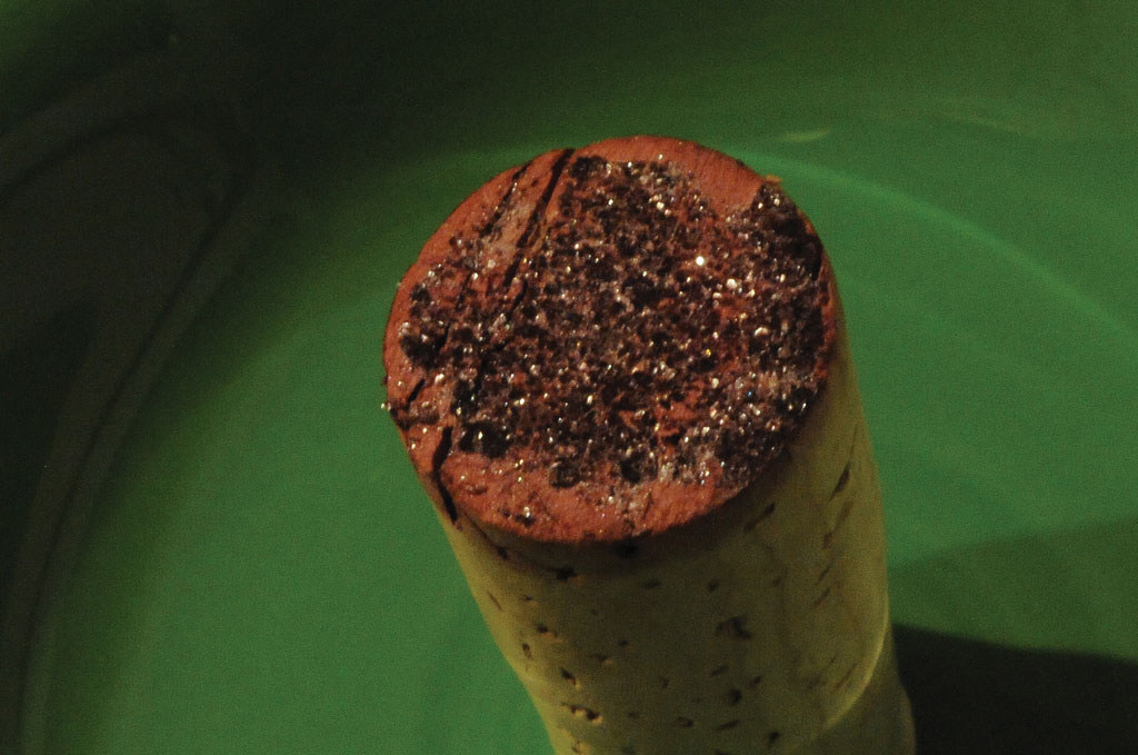 Photo of wine cork with red crystals on one end